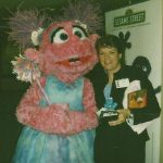 Laura Cosacchi with Sesame Street Character